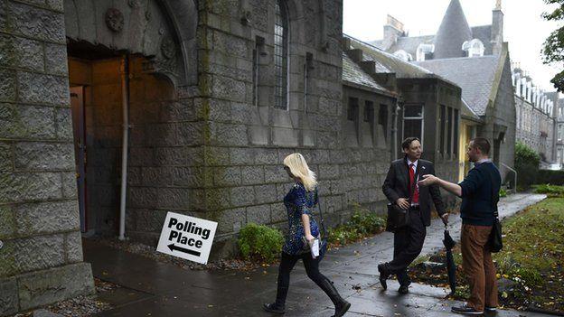 A voter arrives to cast her ballot at the Queen's Cross parish church in Aberdeen