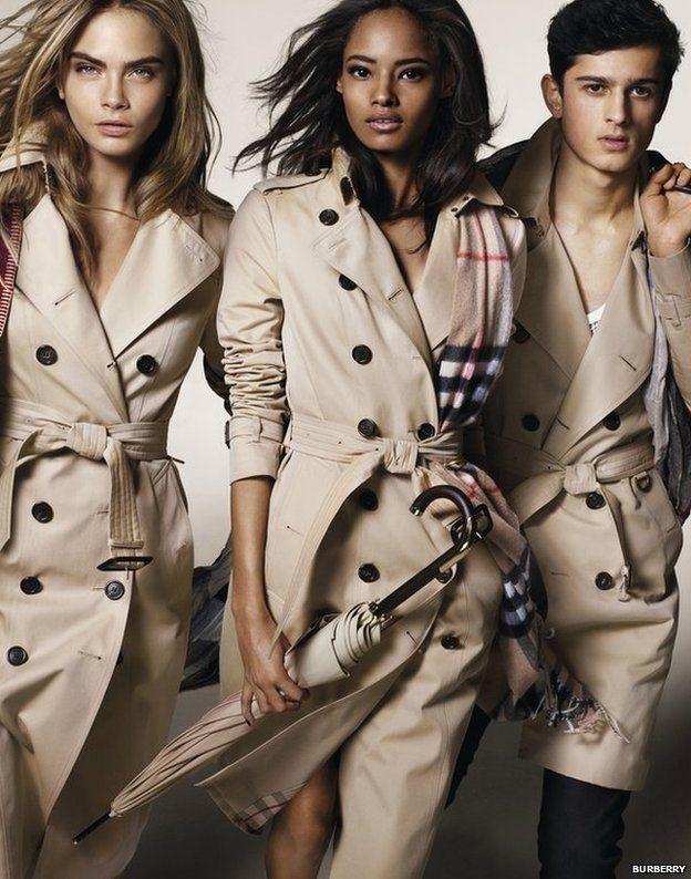 Models Cara Delevingne, left, Malaika Firth, centre, and Tarun Nijjer feature in Burberry's latest ad campaign
