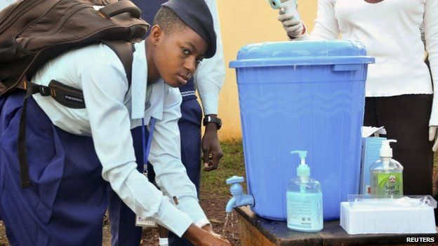 A pupil ashes her hands in Abuja, Nigeria, on 22 September 2014