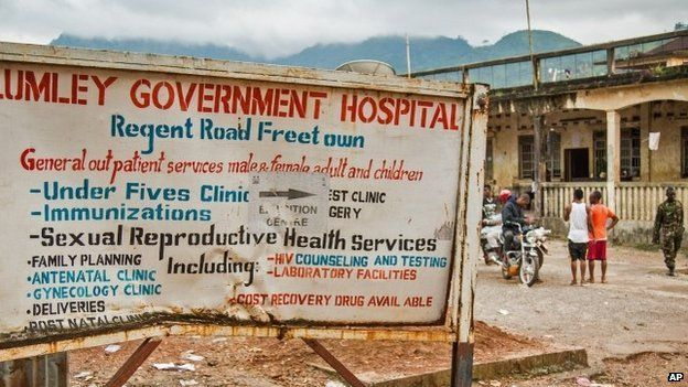 A sign board showing directions to the Lumley Government Hospital, where medical doctor Olivet Buck worked before contracting the Ebola virus and passing away on Saturday near the city of Freetown, Sierra Leone, 15 September 2014