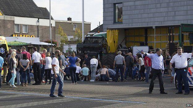 Onlookers help the injured in Haaksbergen. 28 Sept 2014