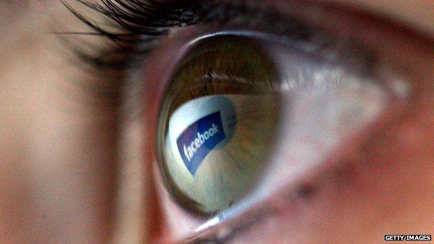 Facebook logo reflected in eyeball