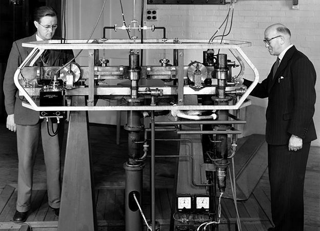 1956: The original caesium resonator which led to the development of the atomic standard time, with J V L Parry (on left) and L Essen, 1956