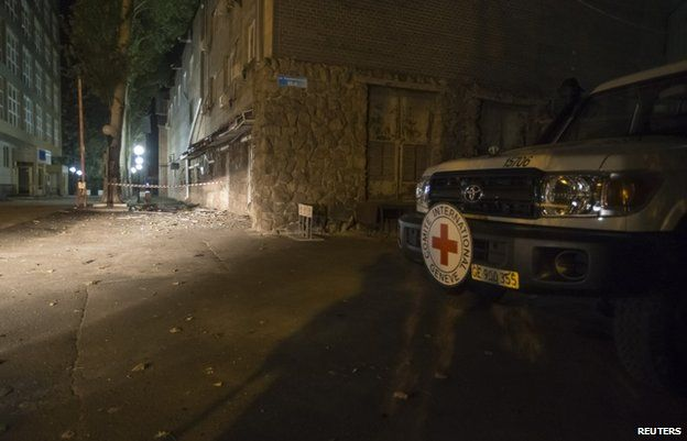 A Red Cross vehicle is parked near the damaged offices of the ICRC in Donetsk, 2 October