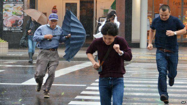 Pedestrians in Myazaki, souther Japan on 5 October 2014