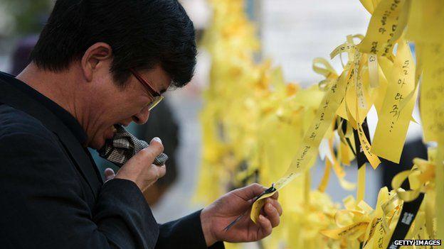 Korean man with Sewol yellow ribbon