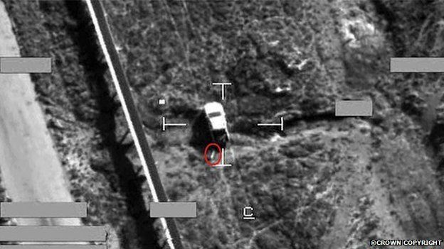 Screen shot of a strike on an IS armed pick-up truck, using a Brimstone missile. The Brimstone missile can be seen here circled in red before impact