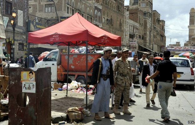 Houthi rebels deployed on the streets of Sanaa on 7 October 2014