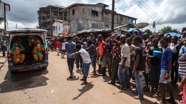 Volunteers arrive to pick up bodies of Ebola victims in Freetown, Sierra Leone - 8 October 2014