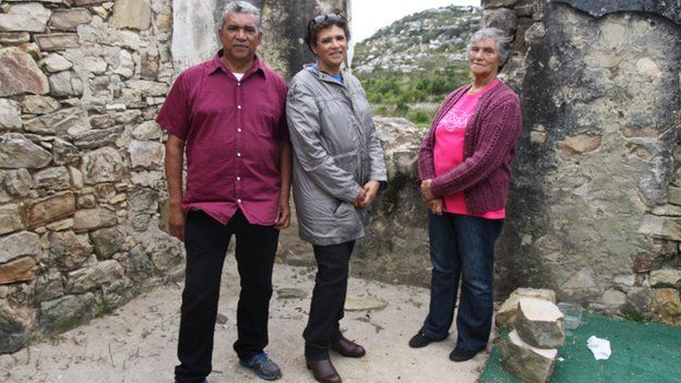 Lily Lawrence with her children at the ruins of their home in South Africa (October 2014)