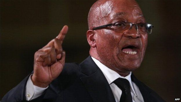 South African president Jacob Zuma speaks during an African National Congress (ANC) led alliance send off ceremony at Waterkloof military airbase on 14 December 2013 in Pretoria, South Africa