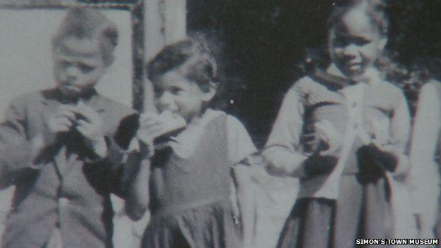 Margaret (middle) in her school uniform