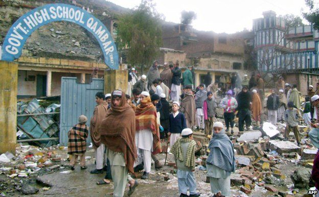 Pakistani students gather outside their school after its destroyed by militants in Kundar village of troubled Swat valley on January 17, 2009.