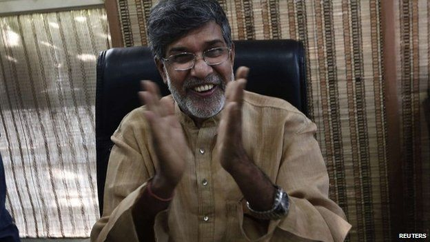 Indian child rights activist Kailash Satyarthi gestures as he speaks with the media at his office in New Delhi - 10 October 2014