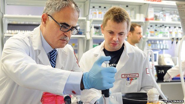 Aids researchers conduct genetic experiments in a Philadelphia laboratory.