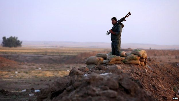 A Kurdish Peshmerga fighter on the front line