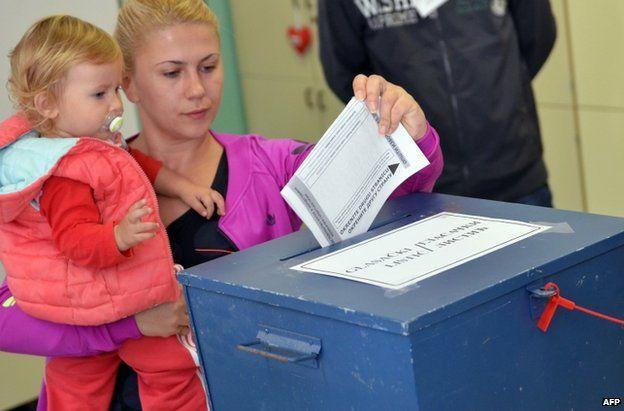 A woman votes in Sarajevo, 12 October