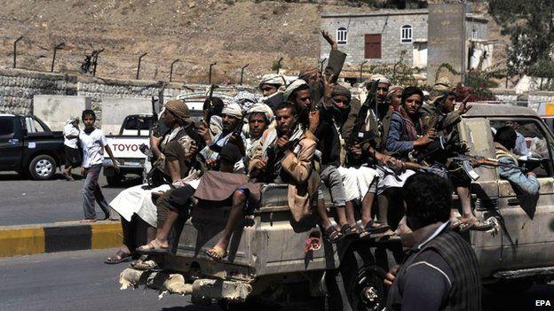 Shia Houthi rebels drive through Sanaa, Yemen on 21 September 2014