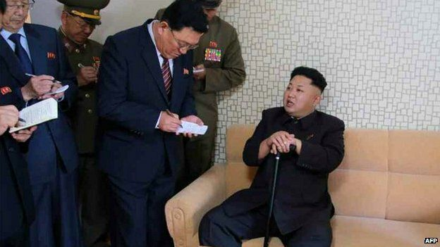 A picture carried by North Korean newspaper Rodong Sinmun apparently of Kim Jong-un visiting a residential area for scientists - 14 October 2014