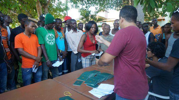 Migrants receive work permits at Rio Branco (October 2014)