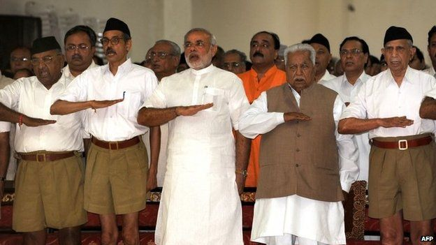 In this photograph taken on September 6, 2009, Narendra Modi (3L) and former chief minister Keshubhai Patel (2R, front) at an RSS gathering in Gujarat