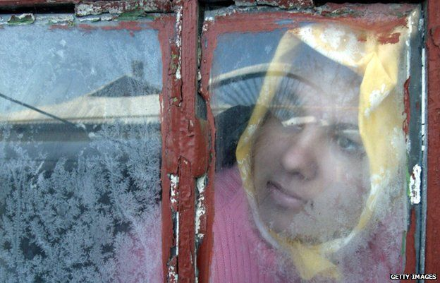 A girl in Donetsk looks through a window as gas supplies are suspended by Russia (Jan 2009)