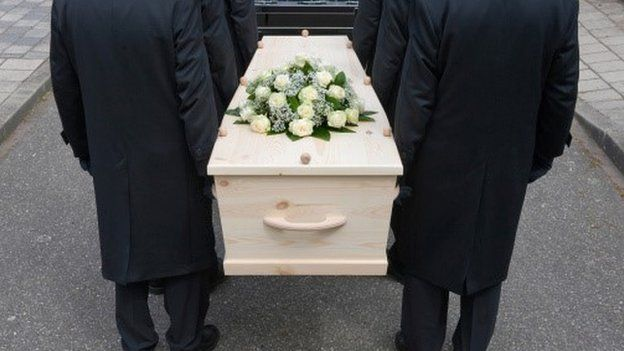 Pallbearers and coffin
