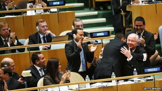 UN representatives for Venezuela, celebrate being elected as a non-permanent member of the United Nations Security Council in New York, US on 16 October 2014