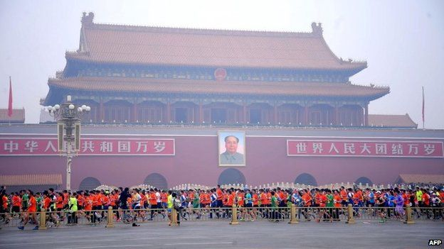 Runners take part in the 34th Beijing International Marathon which began at Tiananmen Square (19th October 2014)