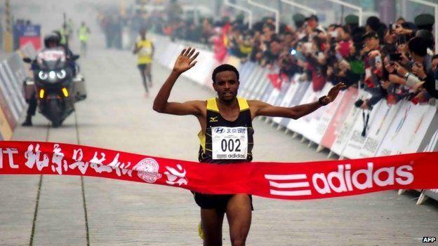 "Ethiopia""s Girmay Birhanu Gebru wins the 34th Beijing International Marathon"