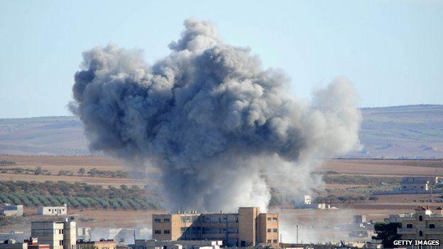 Smoke rises from an airstrike rises in Kobane, Syria