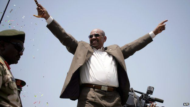 Sudanese President Omar al-Bashir waves to the crowd as he attends for the inauguration of the White Nile Sugar factory near the Al-Dewaim city in the state of the White Nile on 11 July 2012