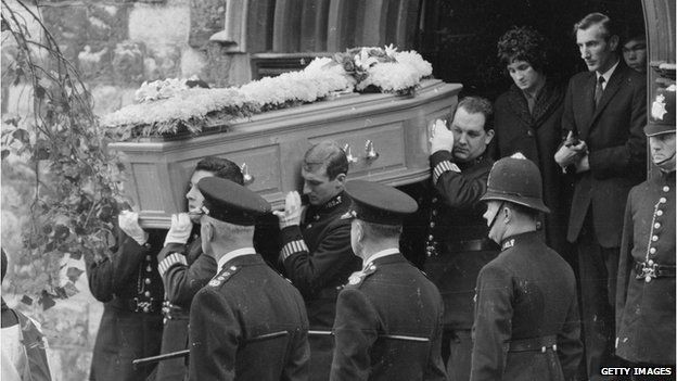 Policemen attending the funeral of three colleagues