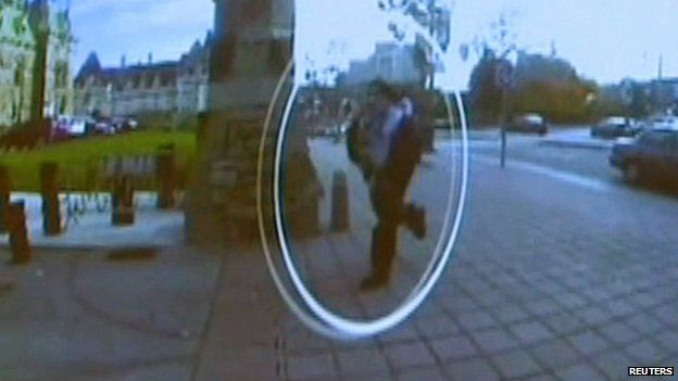 Suspect running towards parliament. 22 Oct 2014
