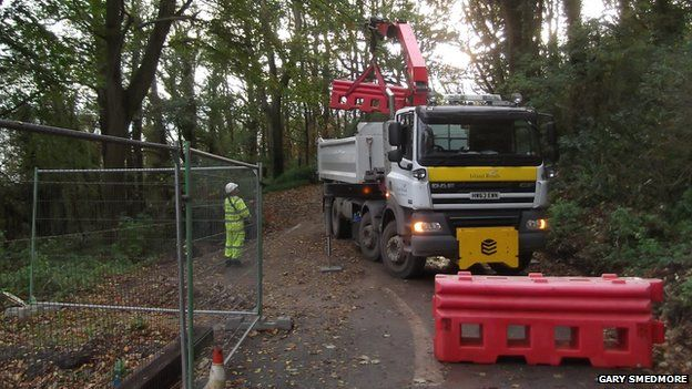 Barriers have been put in place to prevent access to the new road