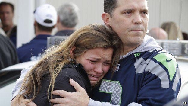 People embraced in Marysville, Washington, on 24 October 2014