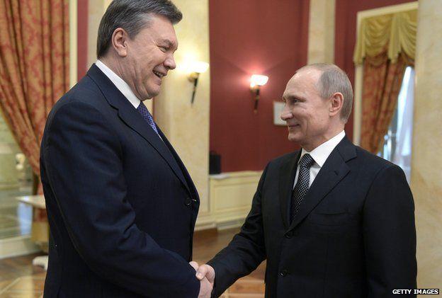 Russia's President Vladimir Putin (right) shakes hands with Viktor Yanukovych in February 2014