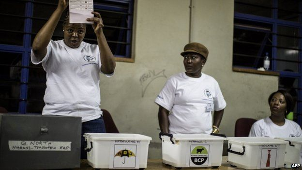Polling officers count ballot boxes at a counting centre in Gaborone on 24 October 2014 during the Botswana general elections.