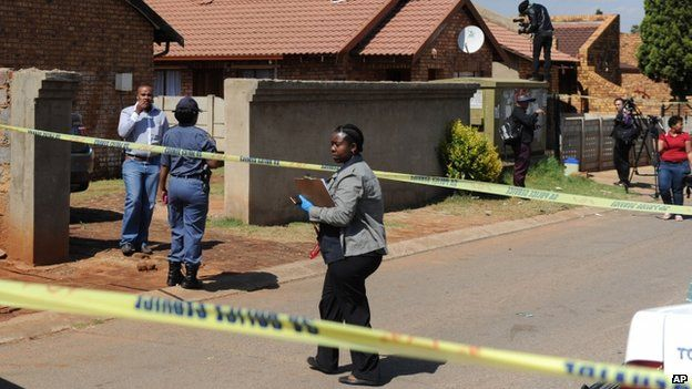 Police work outside the home ofKelly Khumalo, in Vosloorus, Johannesburg in South Africa on 27 October 2014