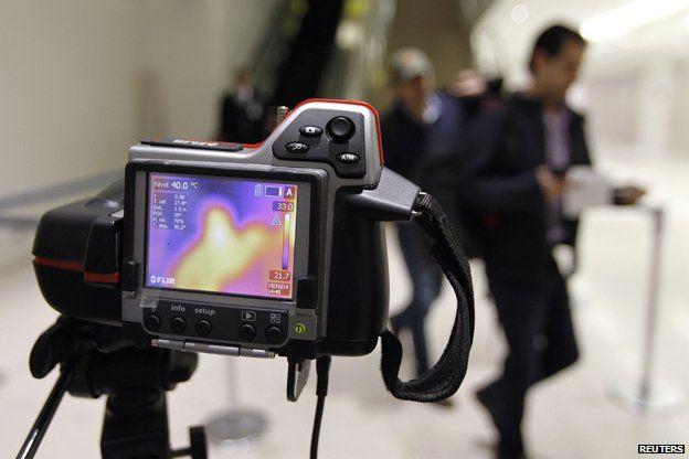 A thermal camera monitors body temperature of passengers arriving in Tocumen airport, Panama City