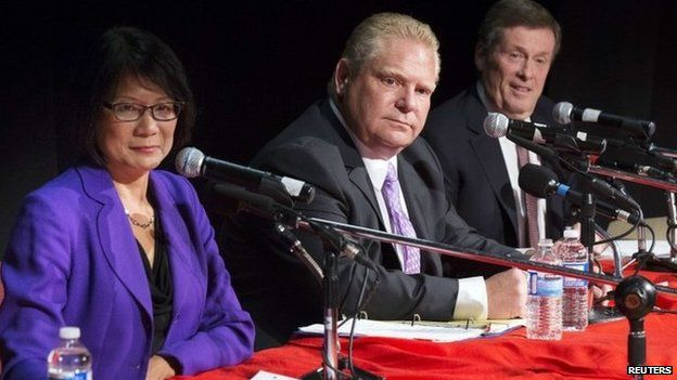 Toronto mayoral candidates Doug Ford, Olivia Chow (L) and John Tory (R) take part in a municipal debate for the upcoming city election in Toronto 23 September 2014