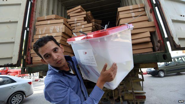A Tunisian employee of the Independent High Authority for the Elections (ISIE) unloads ballot boxes ahead of the counting process in the Tunis suburb of Ariana on October 27, 2014.AFP PHOTO / FETHI BELAIDFETHI BELAID/AFP/Getty Images
