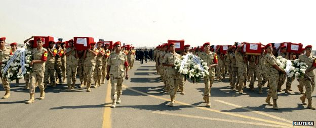 Soldiers in Cario carry the coffins of fellow soldiers killed in an attack in Sinai last week - 25 October 2014