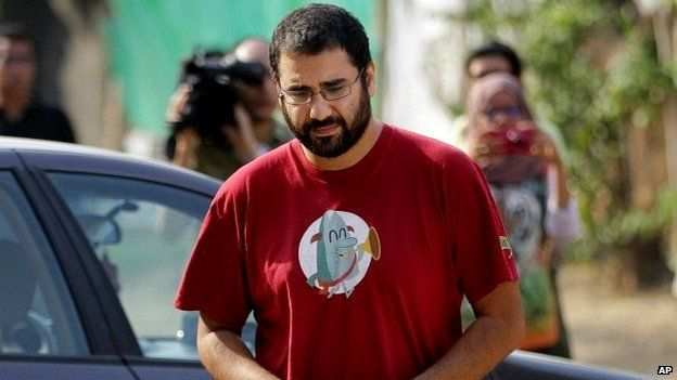Alaa Abdel-Fattah arrives outside a court in Cairo - 26 October 2014