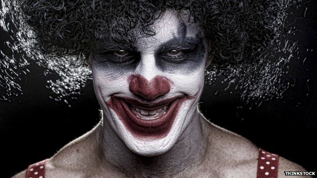 Evil clown smiling