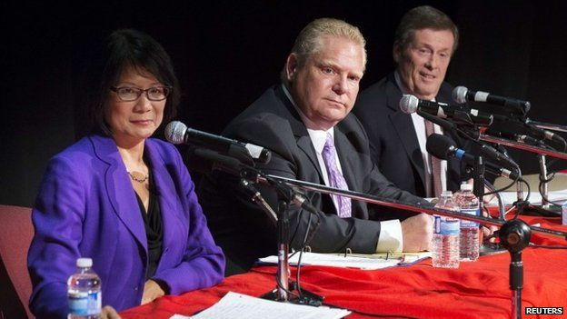 John Tory (right) with Doug Ford and Olivia Chow