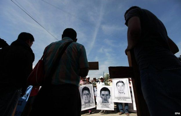 Relatives of the 43 missing students attend a mass at the same place where three students were killed on 26 September