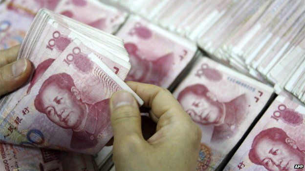 This picture taken on 24 September 2013 shows Chinese 100 yuan (RMB) bank notes being counted at a bank in Huaibei, in eastern China's Anhui province