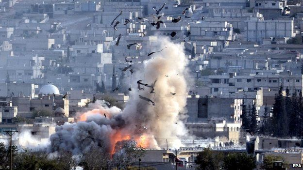 An explosion after an air strike in Kobane, Syria, on 27 October 2014