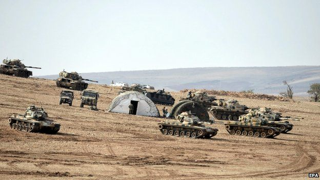 Turkish soldiers and tanks near the Turkish-Syrian border on 27 October 2014